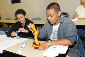 DSC_8266-Students working with robotics in Engineering the World wotkshop.