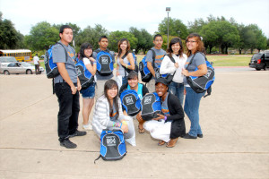 DSC_8705-Upward Bound students show off their backpacks received from Keepin' It Real! 2011.